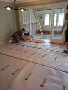 The underlayment going down! Make sure you pick the correct underlayment for the room!