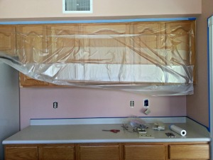 Using plastic sheeting with the tape attached saved me so much time and sanity when we were updating our kitchen! To see the full process click here.