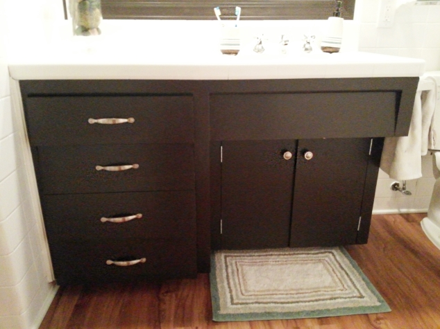 The finished vanity! I used hardware left over from our kitchen cabinets to give them a significant upgrade.