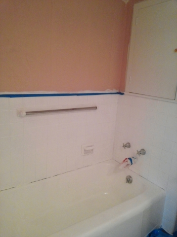 When we took out the chaulk to prep the tile, we learned that the tub and sink both used to be teal...yep, pink and teal?!
